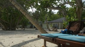 Beach house, Villa on a tropical island. Maldives. 4k stock video footage