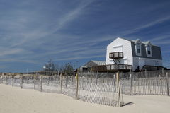 Beach House With Hurricane Shutters Erosion Fence Stock Image
