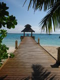 Beach House And Wood Bridge. This is a jetty on an island in Maldives Stock Photos