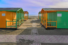 Beach house yellow and green. Beach houses, yellow and green at the seaside Stock Photography