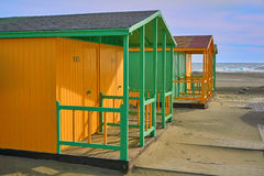 Beach house yellow and green. Beach houses, yellow and green at the seaside Royalty Free Stock Images