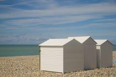 Beach houses. White recreational beach cabin houses royalty free stock photo