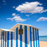 Beach houses in Alicante Denia blue and white stripes. At Mediterranean sea of Spain stock image