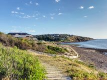 Beach houses on a cliff at Hallett Cove Beach. Image contains some beach houses on a cliff. Some of the coastline is visible. A path is also present at the Royalty Free Stock Photos