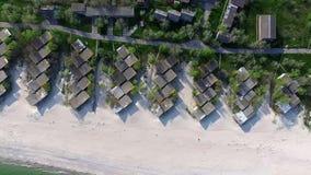 Beach with houses on the coastline stock footage