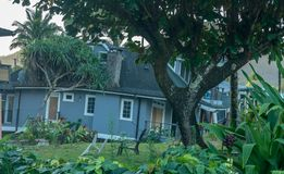 Beach houses collapsed after heavy rain in April 2018 in Hanalei. Two beach homes sinking into sink hole after the massive rain storms of April 2018 on Kauai stock photos