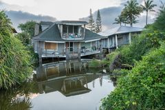 Beach houses collapsed after heavy rain in April 2018 in Hanalei. Two beach homes sinking into sink hole after the massive rain storms of April 2018 on Kauai royalty free stock photography