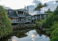 Beach houses collapsed after heavy rain in April 2018 in Hanalei. Two beach homes sinking into sink hole after the massive rain storms of April 2018 on Kauai stock photography