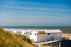 Beach houses at the Dutch coast. Row white beach houses at the Dutch coast Royalty Free Stock Images