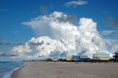 Beach Houses in Gulf Shores. Beach houses in Golf Shores, Alabama; with cumulus clouds in the background royalty free stock photography