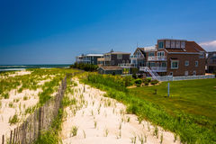 Beach houses and sand dunes in Strathmere, New Jersey. Beach houses and sand dunes in Strathmere, New Jersey Stock Photos