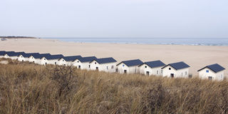 Beach houses on the sea strip behind the dunes Royalty Free Stock Photography