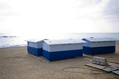 Beach houses on the Spanish coast. Scenic view of small huts on a sandy beach, Spain royalty free stock images