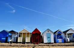 Beach houses under blue sky stock images