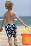 Beach Hunter. Young boy searching the sand for treasures Stock Photography