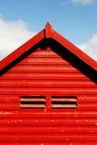 Beach Hut. Red beach hut against a blue sky stock photo