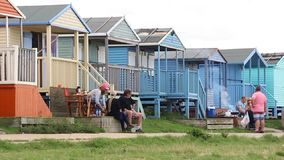 Beach hut bbq. Video footage of people at their beach huts with picnics and bbq stock video