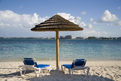 Beach hut and chairs on tropical island Royalty Free Stock Photography