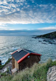 Beach Hut on Cliffs Stock Photography