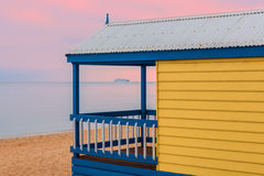 Beach hut and cruise liner at sunrise Stock Image