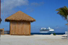 Beach hut and cruise ship. Beach hut near the ocean with cruise ship in view Stock Images