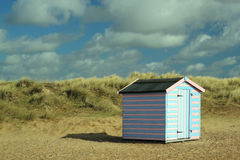 Beach hut in the dunes. Royalty Free Stock Photo