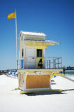 Beach hut on a Florida beach. Yellow flag flying from a traditional beach hut on the white sand of a beach, Florida, U.S.A Royalty Free Stock Photo