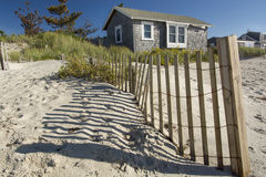 Beach Hut West Dennis Cape Cod. A beach hut/house and fencing @ West Dennis beach Cape Cod Massachusetts Royalty Free Stock Photography