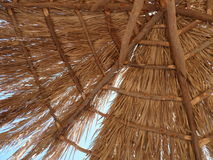 Beach hut. Looking up at a palm beach hut with summer sun shining through Royalty Free Stock Photography