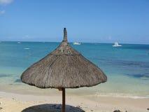Beach Hut near blue sea. In Mauritius Stock Image