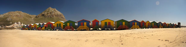 Beach hut panoramic. A panoranic view of a row of beach huts in Muizenburg, Cape Town South Africa Royalty Free Stock Photo