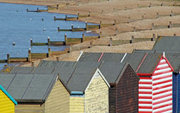 Beach hut roofs and breakwater Royalty Free Stock Photo