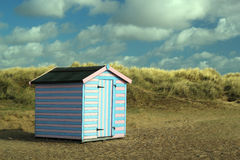 Beach hut in the sand dunes. Stock Photo