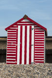 Beach Hut at Seaton, Devon, UK. A red and white striped beach hut on the beach at Seaton, Devon, UK Stock Images
