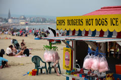 Beach hut selling sweets and fast food. Beach hut selling ice cream burgers candy floss and sweets on Weymouth beach in Dorset Stock Photography