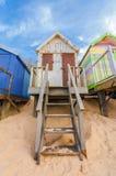 Beach hut. Weathered beach hut on golden sand Stock Photography