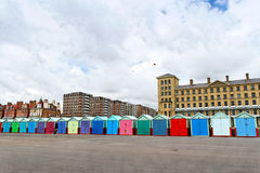 Beach Huts. A roll of colourful beach huts along King's Esplanade with King's House behind on the right hand side stock photography