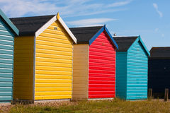 Beach huts. Colourful beach huts in summer sunshine royalty free stock photography