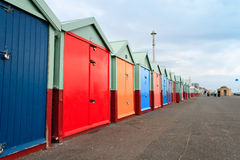 Beach huts. Colourful beach huts along Brighton Beach (Southern coast of Britain royalty free stock images
