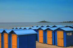 Beach Huts. Rows of blue and orange beach houses line the beach. Sicily Italy Stock Photography