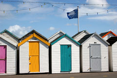Beach huts. Row of beach huts with different colour doors Royalty Free Stock Photography
