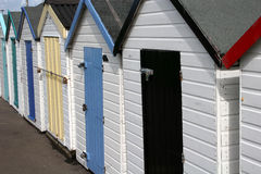 Beach huts. Row of beach huts with multicoloured doors Stock Images
