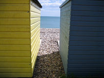 Beach huts. A pair of colourful beach huts with a view to the sea royalty free stock photo