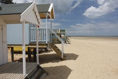 Beach huts. Painted beach huts on a deserted beach Royalty Free Stock Photography