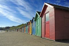 Beach huts. A row of multi-coloured beach huts Royalty Free Stock Photo