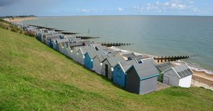 Beach Huts along Felixstowe Seafront. With beach and groynes and the north sea Stock Photography