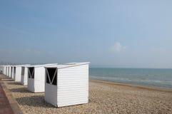 Beach huts along seafront, Weymouth Stock Photo