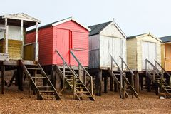 Beach huts on the beach. With various colours and they look old Royalty Free Stock Photography