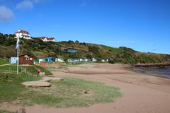 Beach huts and beach, Coldingham Bay, Scotland stock photography