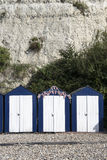 Beach Huts at Beer, Devon, UK. Blue and white painted beach huts at Beer, Devon, UK Stock Images
